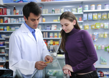 pharmacist teaching the customer about her medicine